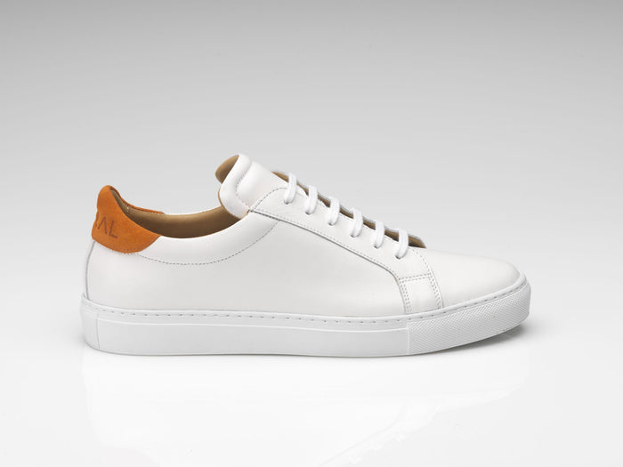 white orange suede sneakers with white rubber soles