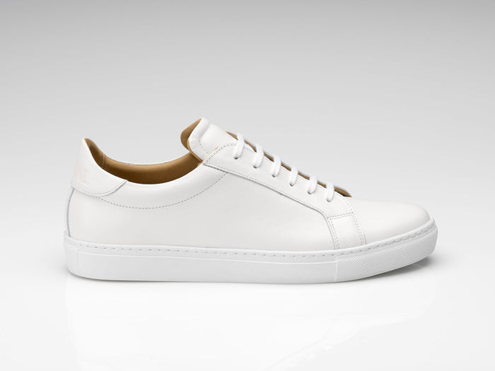 white leather sneakers with white rubber soles