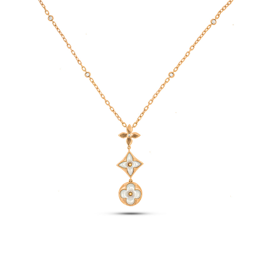 Trail necklace with 3 Specials flowers pendant cast in 18K rose gold, 2 perfect Mother of pearl & 9 brilliant cut round diamonds.