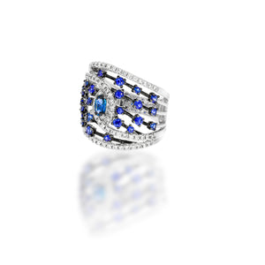 Stunning engagement ring, in a unique design, 25 blue sapphire and 68 white round natural diamonds in 18K white gold.