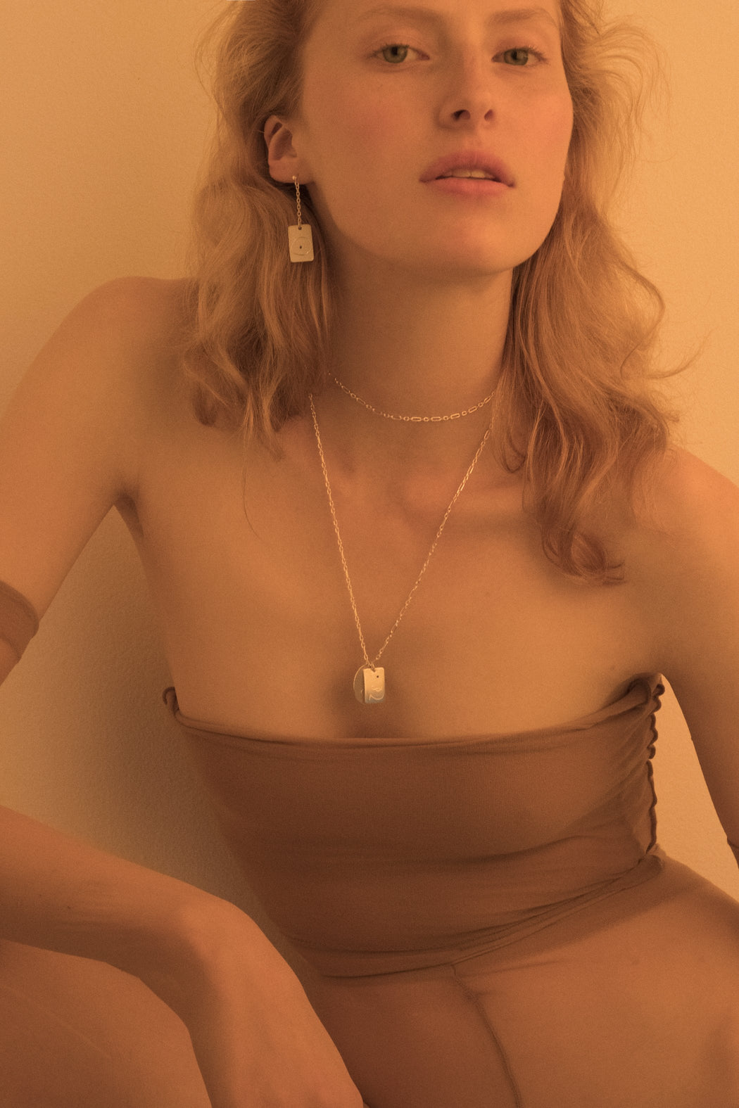 Model wearing gold plated chain doubled around neck. Necklace can be worn long or twice around neck.