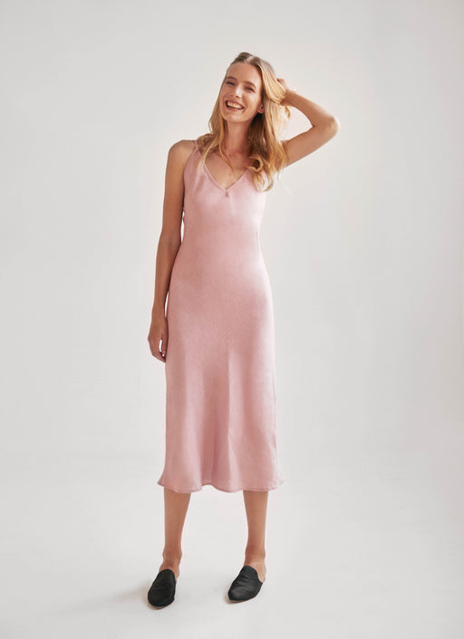100% pink linen slip with adjustable straps.