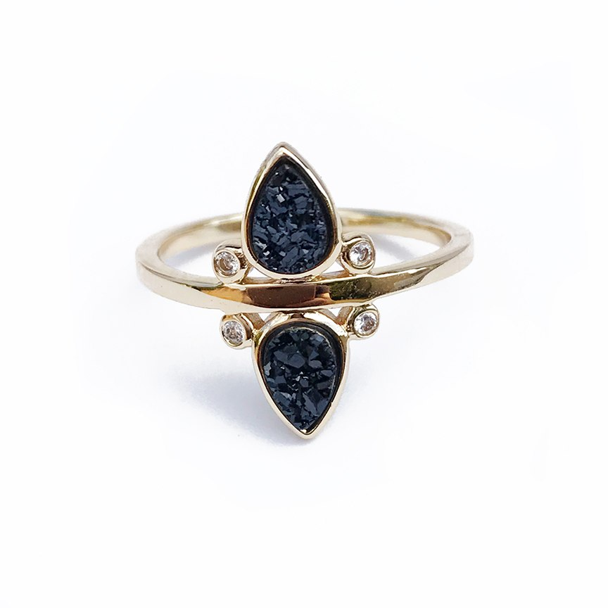 2 Black Druzy gems with cubic zarconia details set in a 14k gold plated ring.