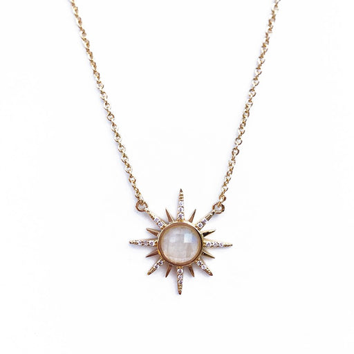 14K gold plated starburst shaped necklace with 16 inch chain. Moonstone center.