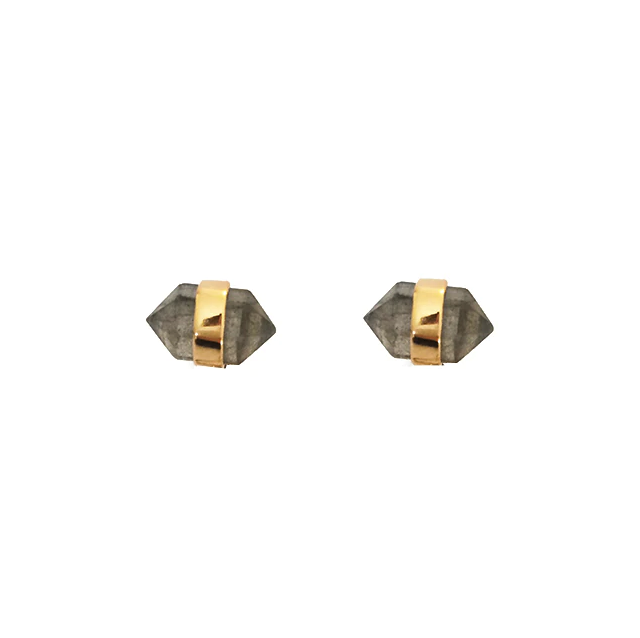 Gemstone and gold diamond-shaped stud earrings. Gold center is trimmed with triangular white gemstones on each side for a sophisticated cat eye look.