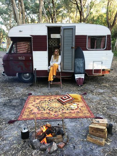 Hand drawn cotton canvas picnic rug outside vintage camper.