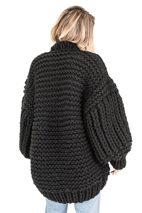Black over sized handmade knit that comes with  balloon style sleeves