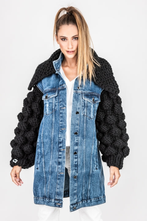 Oversized boyfriend fitted jean jacket with hand-knitted statement sleeves and funnel neck.