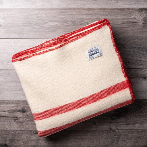 Canadian made queen sized wool blanket with red stripe.