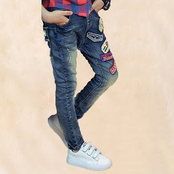 The slim elastic boy jeans pants