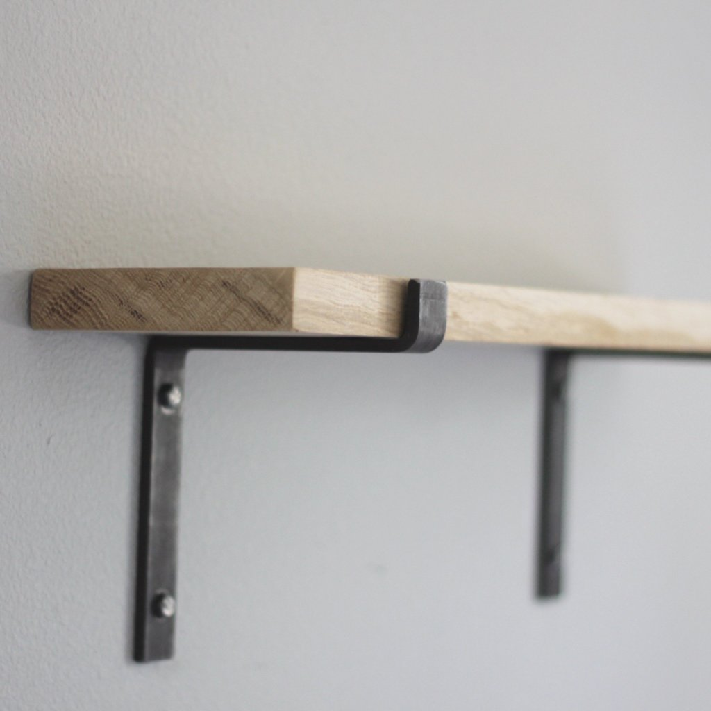 salvaged wood shelf with metal brackets