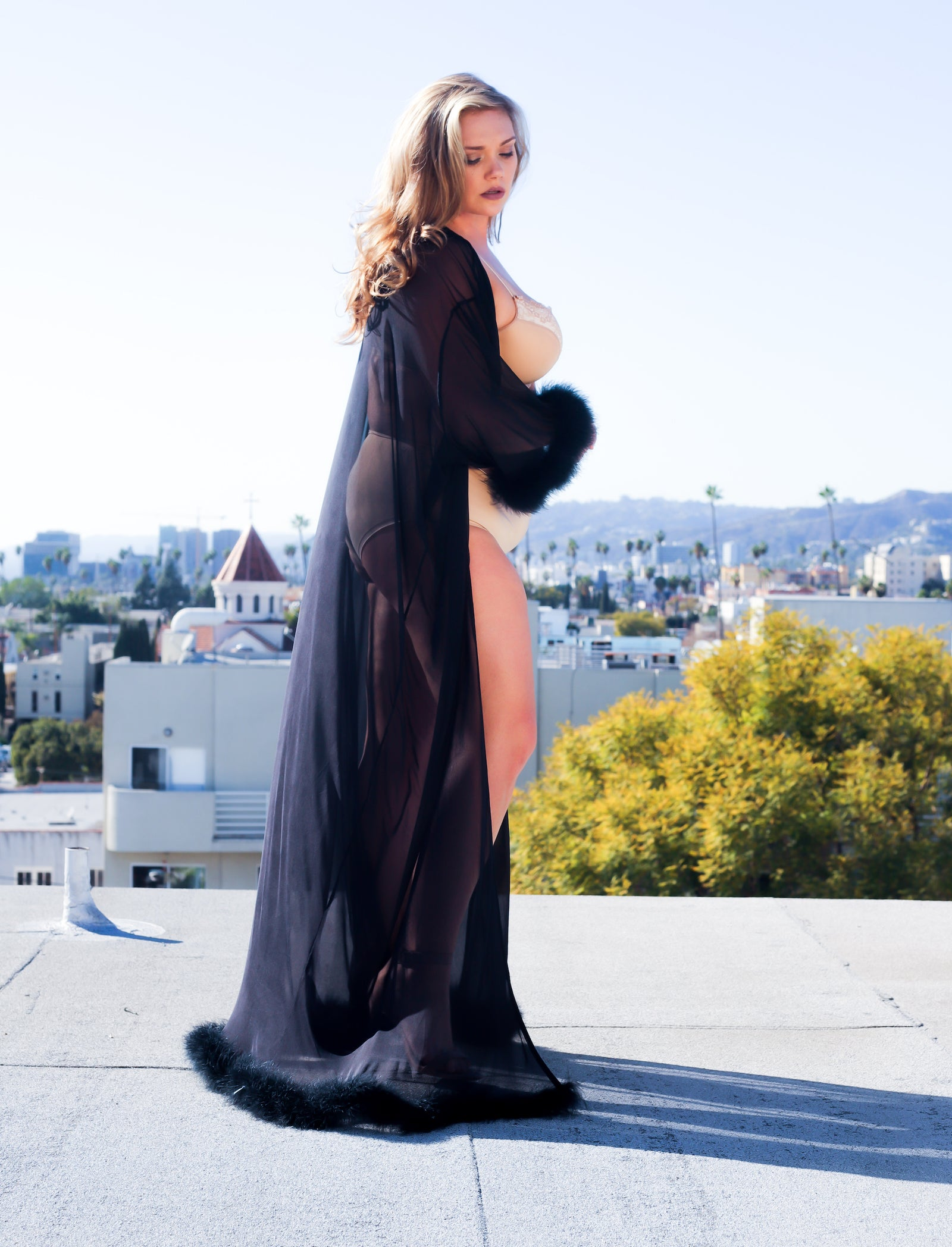 Plus size model Kelsey Olson wearing proud mary fashion marabou robe in Los Angeles. Shot by Jessica Hinkle.
