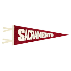 "A red pennant that says ""Sacramento"" with the map of California in the S."