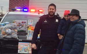 Michigan Officers Stop Cars to Give Children Christmas Eve Gifts