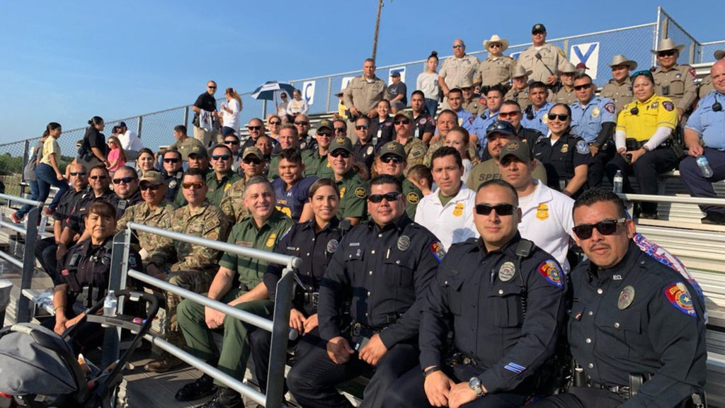 Teen's dad died in the line of duty, so dozens of police came to watch his first football game