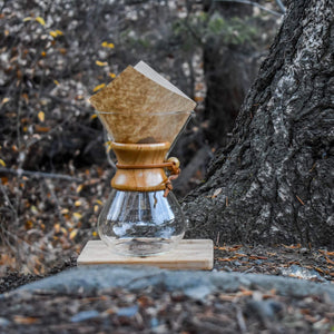 Brewing Coffee Using A Chemex Coffee Maker Outdoors