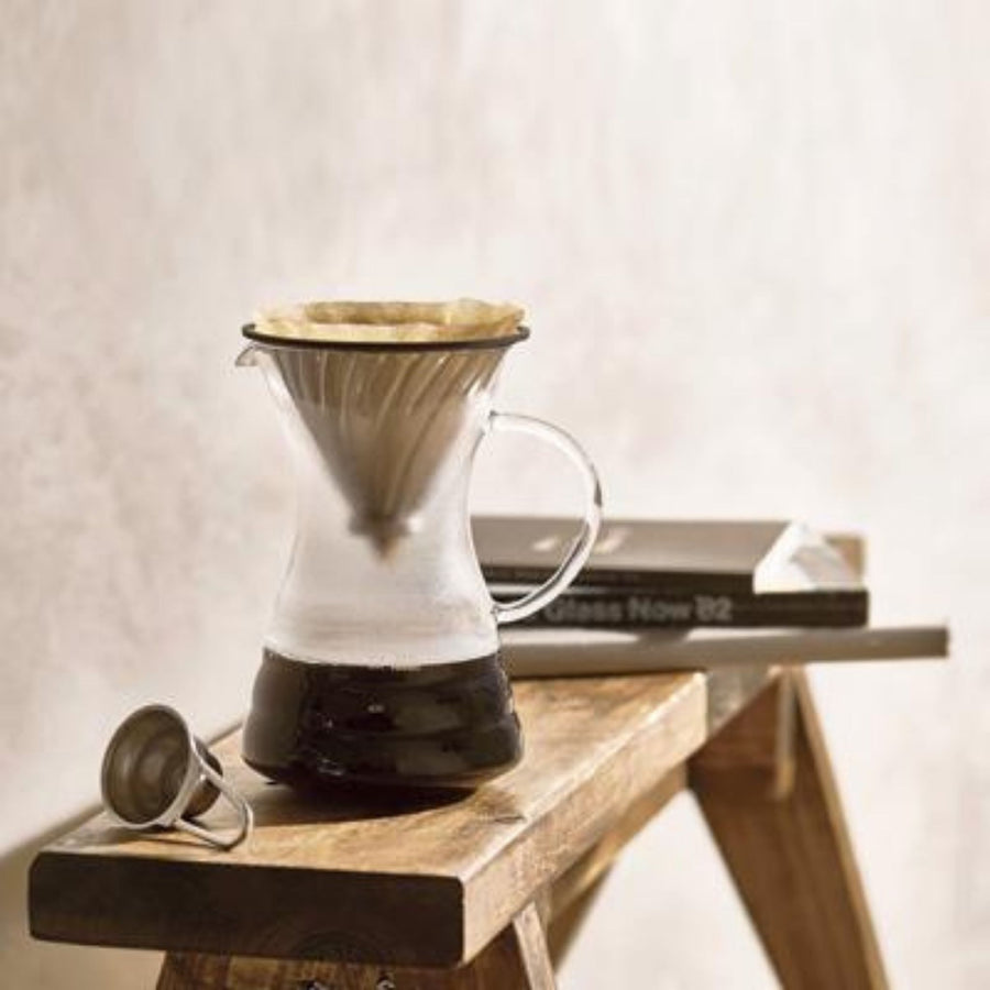 Hario Pour Over Coffee Kit On Wooden Bench With Coffee Brewing
