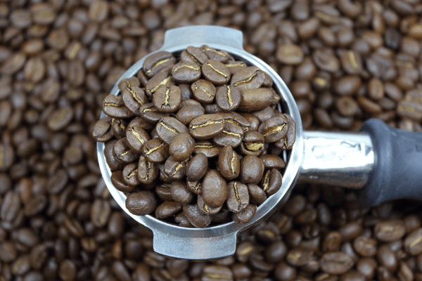 coffee beans in a group head for an espresso machine
