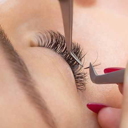 Person getting individual mink lashes