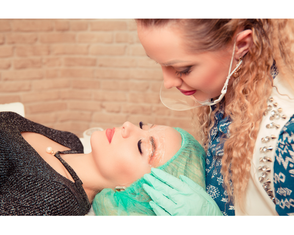 permanent makeup artist holding a clients head during microblading procedure