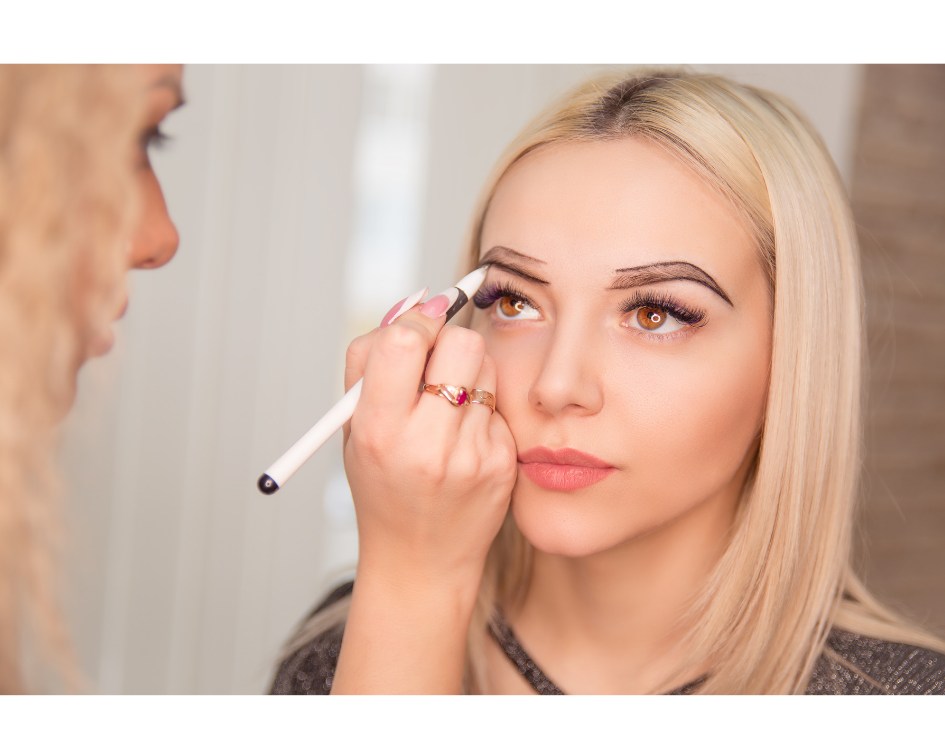 Permanent makeup artist drawing eyebrows for embroidering procedure
