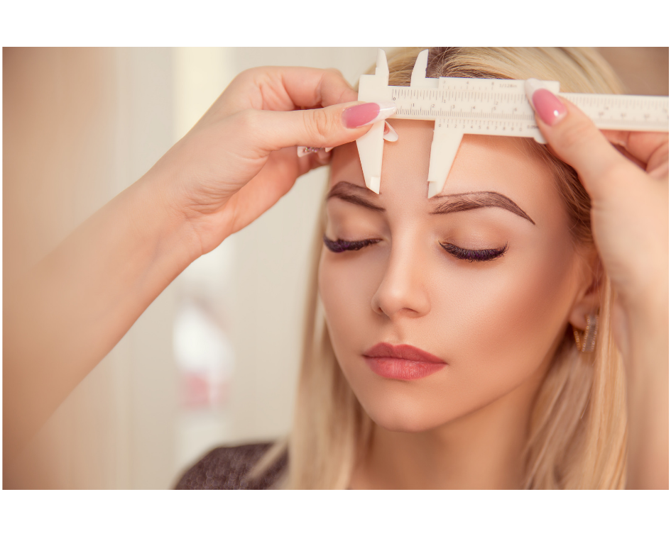 Permanent makeup artist Measuring womans eyebrows for microblading procedure