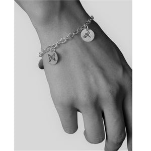 Sterling silver charm bracelet.  Showcasing dragonfly and butterfly symbols.