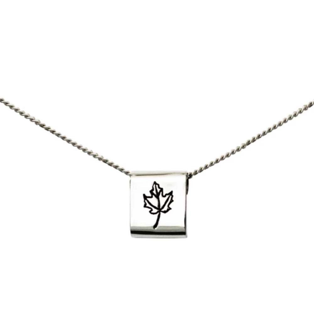 Sterling silver square necklace with Canadian symbols.