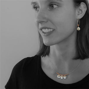 Mini Circle Earrings on Model.  Copper accent beads.  Dragonfly symbol pictured here.