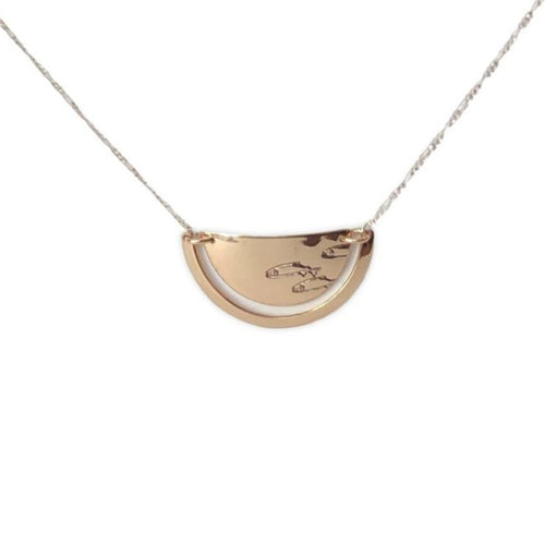 14 karat gold-fill and sterling silver Sunrise Ulu Necklace. Salmon spawning symbol pictured here.
