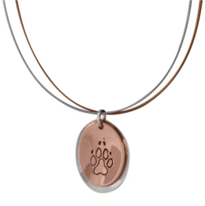 Copper and sterling silver oval necklace with Canadian symbols.  Dog paw print symbol pictured here.