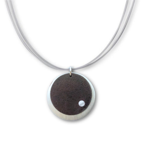 Vintage Round Necklace featuring recycled vintage round tin riveted onto a round pewter layer.
