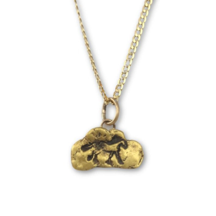Gold nugget Horse pendant on 10 karat gold chain.