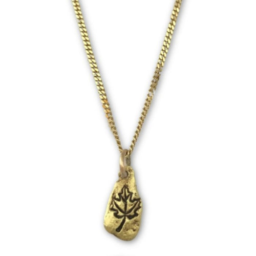 Gold nugget maple leaf pendant on 10 karat gold chain.