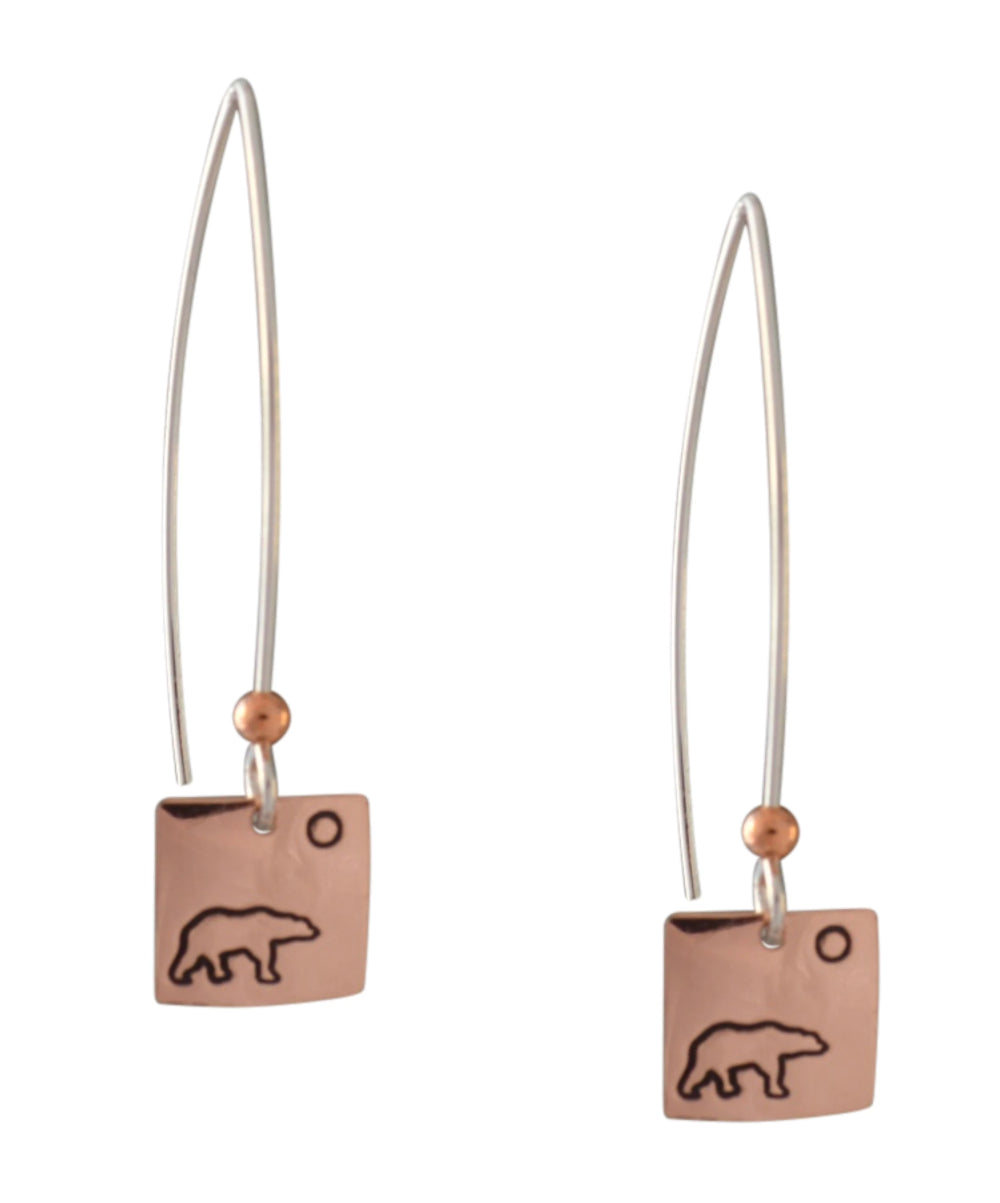 Copper and sterling silver round earrings with Canadian symbols.  Polar bear symbol pictured here.