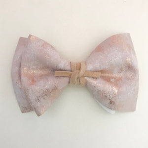 PHOENIX BOW // metallic brushed rose gold