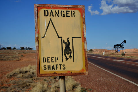 Mine shaft warning sign in Coober Pedy South Australia