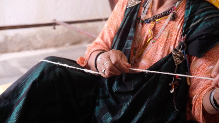 spinning wool thread by hand ethical clothing