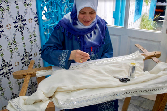 craftswoman working handmade north african tunisian traditional ethical clothing arab fashion tuniq hand embroidery hayek