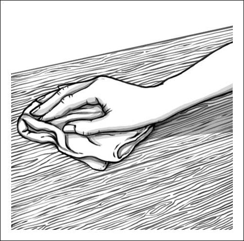 Hand with polishing cloth cleaning work surface