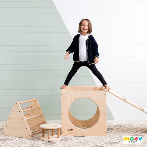 Boy playing on Moovbaby  Timber Play Equipment