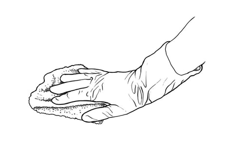 Gloved hand with cloth