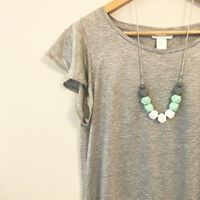 mint necklace on teeshirt