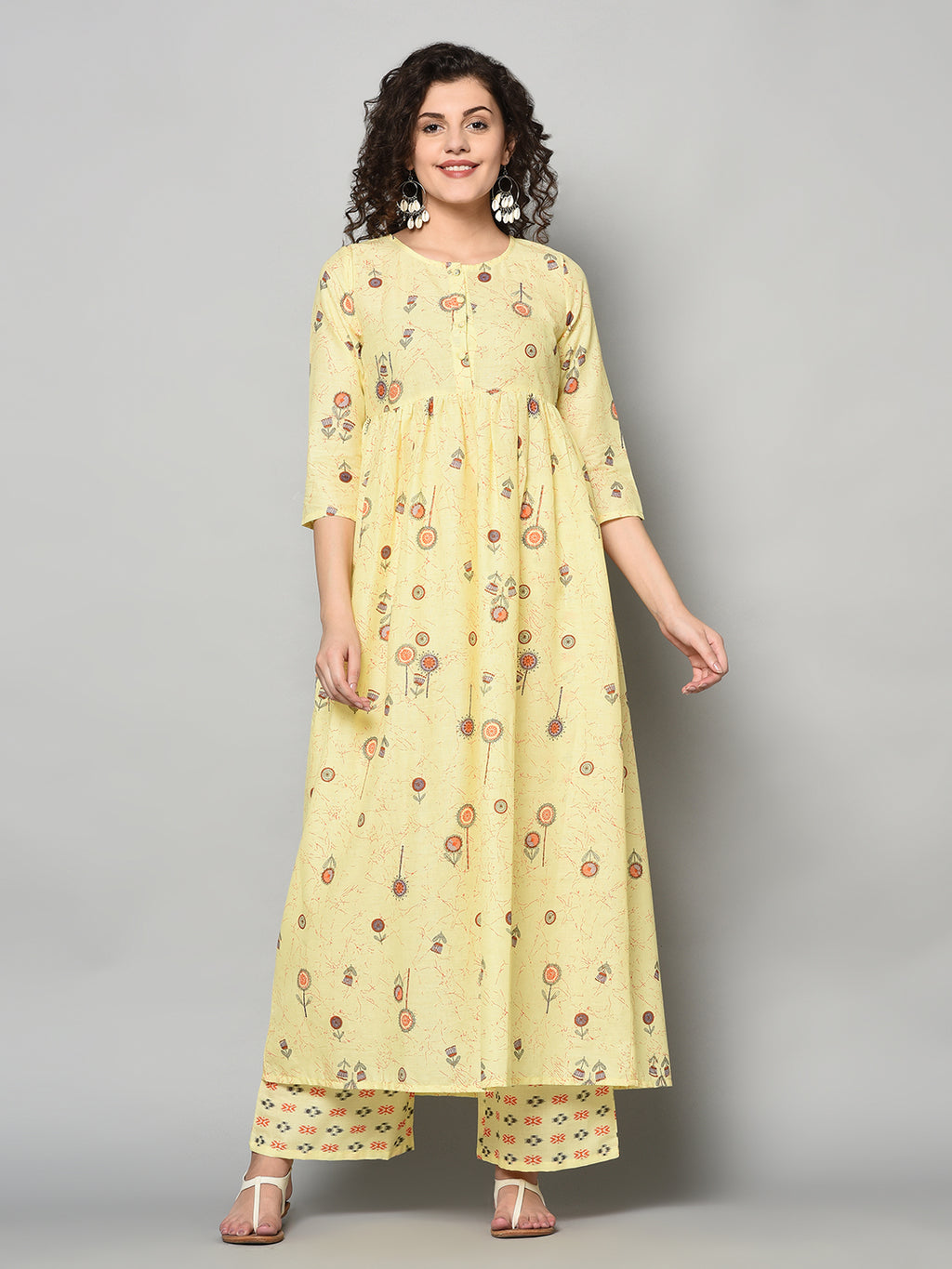 ZNX Women Yellow Printed Flared Kurta with Palazzo Set (Fully Stitched)