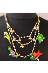 Multi motiff hanging pearl necklace