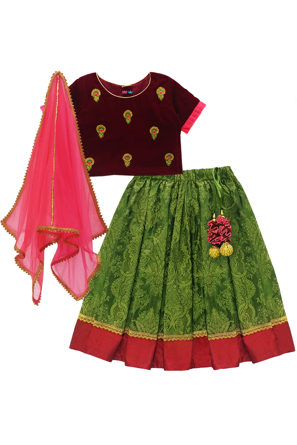 Maroon velvet choli with green lehenga and net dupatta