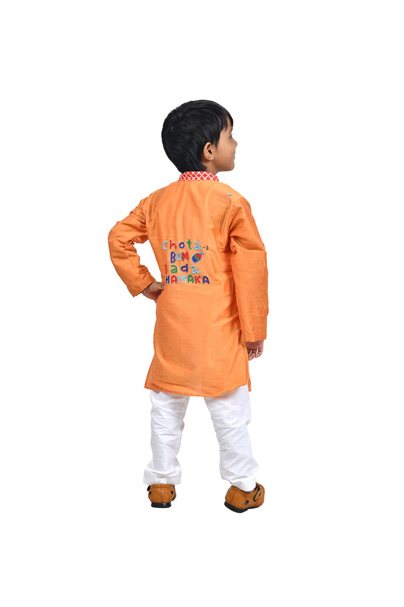 Orange kurta with one liner and white churidar