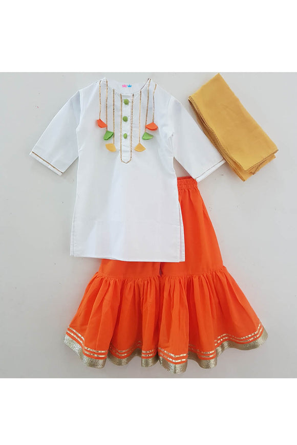 White kurti with orange sharara and dupatta