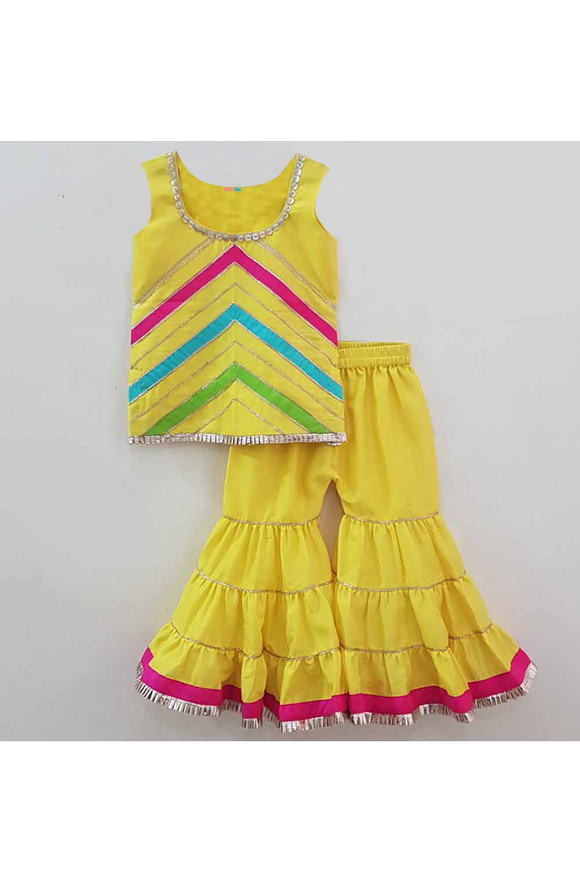 Yellow chroma silk kurta and sharara set! Designer Ethnic Wear For Girls, Designer Ethnic Wear For Baby Girl, Latest Ethnic Wear For Girl, Designer Lehenga Wear for Girls, Designer Indian Wear for Girls, Designer Salwar Suit for Baby Girls, Ethnic Wear for Baby Girl, Designer Indo Western Wear for Girls