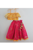 Yellow embroidered ruffle top with pink brocade skirt